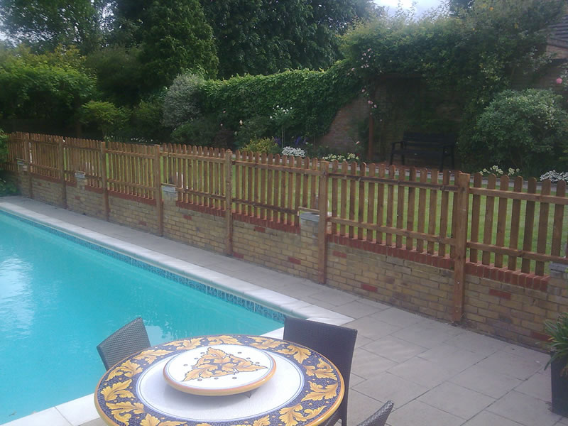 Picket fencing around pool